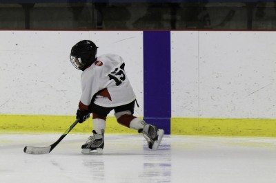 child playing hockey