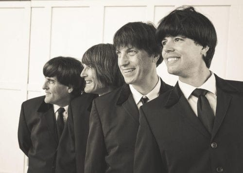 Picture of the 4 band members of the band, a hard days night.